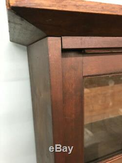 American cherry cabinet with sliding doors divided light blown glass doors c1830